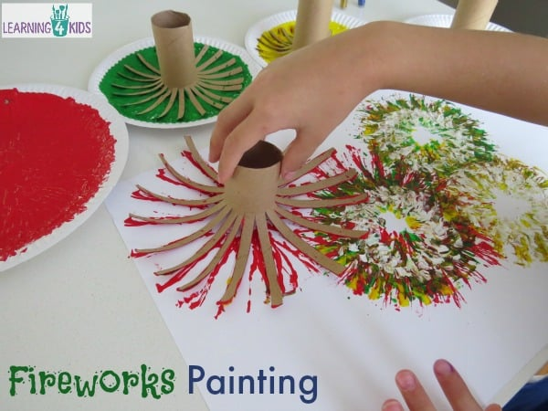 making-fireworks-with-paint-and-cardboard-rolls-great-new-years-celebration-activity